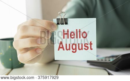 Business Woman Showing A Post-hello August, Concept August