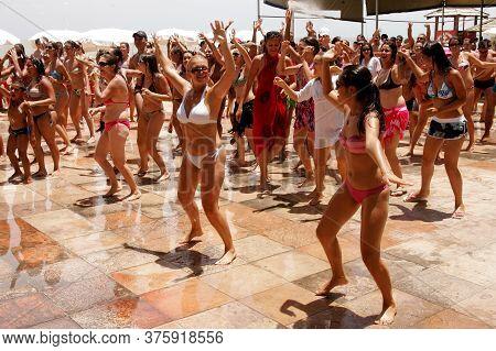 Porto Seguro, Bahia / Brazil - February 24, 2009: Tourists Are Seen Dancing In Choreography With Axe