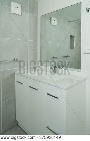 Newly Renovated Ensuite Bathroom With Basin, Mirror And Tiled Walls
