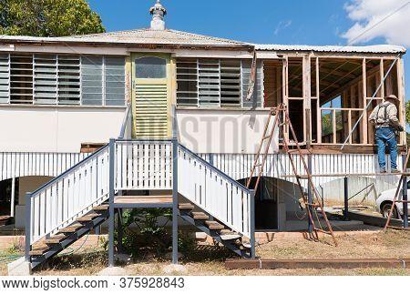 Builder Renovating Old Traditional Queenslander Style High Set Home