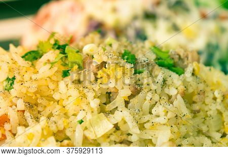 Thai Sour Pork Fried Rice And Salad In Dish With Natural Light In Close Up View In Vintage Tone