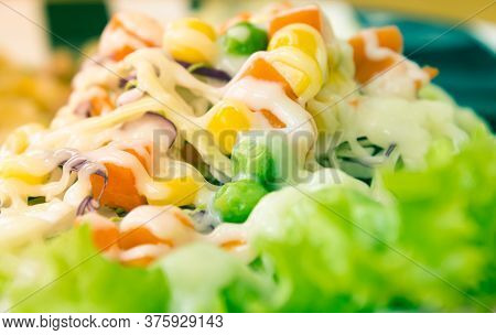 Vegan Or Vegetarian Salad With Mayonnaise Topping In Close Up View Include Carrot And Tomato And Cor