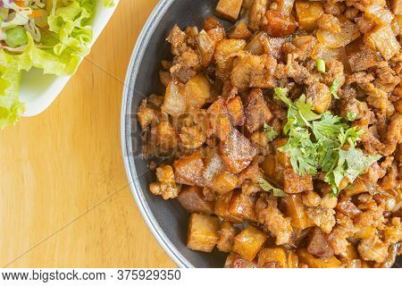 Stir Fried Pork With Onion And Garlic And Black Soy Sauce And Coriander Topping And Tofu With Vegan