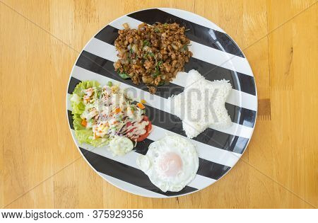 Stir-fried Pork And Holy Basil And Salad And Fried Egg And Rice On Dish. Mix Thai Food Recipe With S