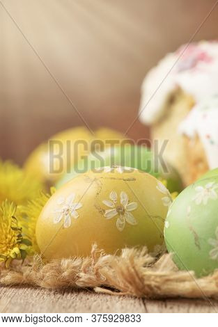 Easter Green And Yellow Painted Eggs, Yellow Dandelion Flowers On Spring Festive Composition In Rust