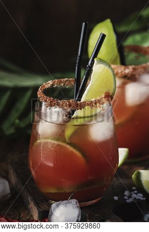 Michelada - Mexican Inspired Bloody Mary Alcoholic Cocktail With Beer, Lime Juice, Tomato Juice, Spi