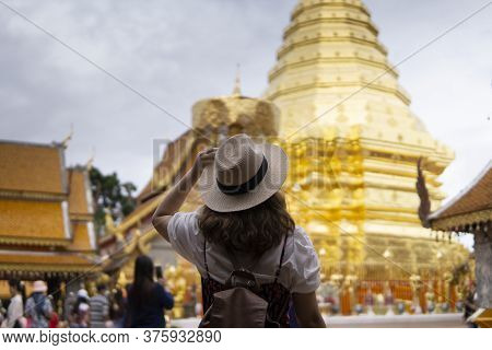 Tourist Woman Is Sightseeing At Wat Phra That Doi Suthep In Chiangmai, Thailand.