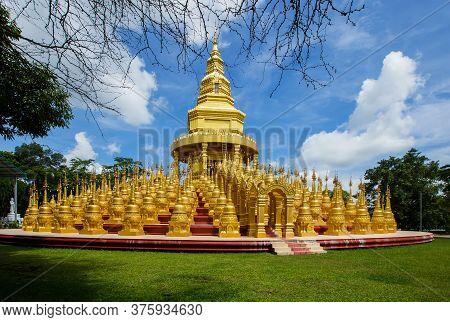 Golden Pagoda At Wat Pa Sawang Bun In Saraburi Province Thailand. There Are 500 Small Pagodas Decora