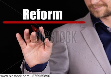 Businessman, Man Writes Marker Text On The Word Reform. Business Concept, Stteryria.