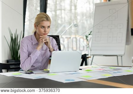 Thoughtful Caucasian Businesswoman Ponder Over Report In Office
