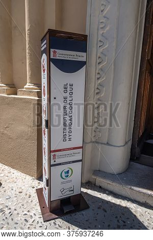Monte Carlo, Monaco - July 4, 2020: Disinfectant Distributor In Front Of The Chapel Of Saint Devote,