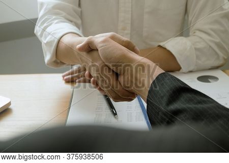 Business Handshake. Business People Shaking Hands, Finishing Up A Meeting,success Agreement Negotiat