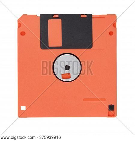 Red 3.5-inch Floppy Disk Or Diskette Isolated On White Background