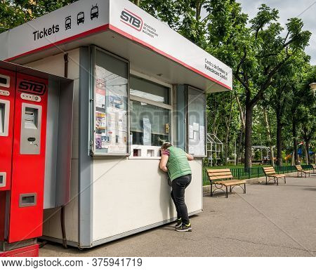 Bucharest/romania - 06.22.2020: Woman Buying A Bus Or Tram Ticket At The Ticket Booth. Public Transp