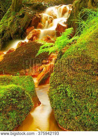 Red Waterfall Sucha Kamenice In The Czech-saxony Switzerland. Red Ferric Sediments On Big Boulders B