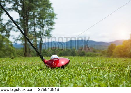 Golf Ball And Golf Club In Beautiful Golf Course At Thailand. Collection Of Golf Equipment Resting O