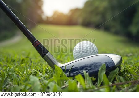 Golf Ball And Golf Club In The Beautiful Golf Course In Thailand. Collection Of Golf Equipment Resti
