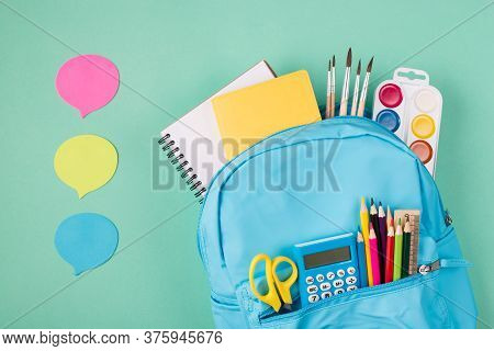 Back To School Concept. Sharing Ideas Concept. Top Above Overhead View Photo Of Blue Backpack Filled