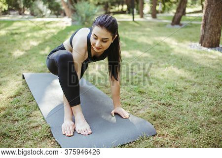 Young Sporty Woman Doing Morning Yoga In The Park. Healthy Lifestyle, Sport, Leisure Activity Concep