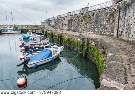 Carnlough, Northern Ireland- July 4, 2020: Fishing Boats In Carnlough Harbor On The Antrim Coast In