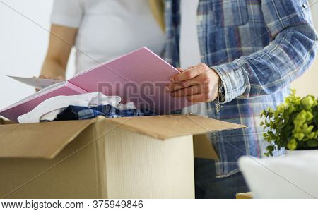 A Just Married Couple Unpacking Boxes And Moving Into A New Home. Positive Emotion.