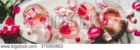 Rose Lemonade With Ice And Pink Rose Petals, Wide Composition
