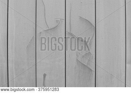Old Wall Covering, Metal Plates. Siding Gray Color With Paint Cracks And Dents. Backdrop Textured Ef