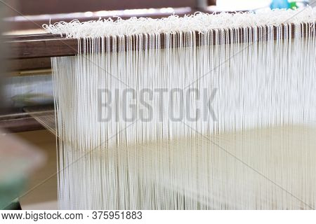 Closed Up Of Loom With White Thread Background