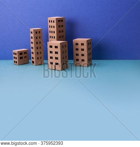 Miniature City With Brown Paper Houses On Blue Background. Abstract Urban Architecture Landscape, Si