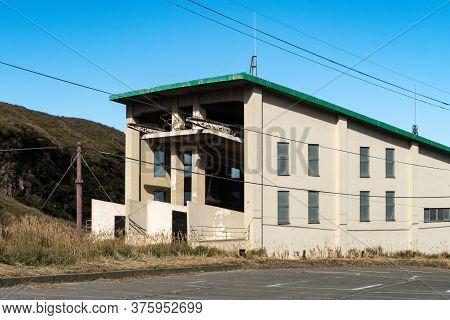 Old Sensuikyo Ropeway Constructions And Buildings At The Foot Of Mount Aso, Active Vulcano On Kyushu