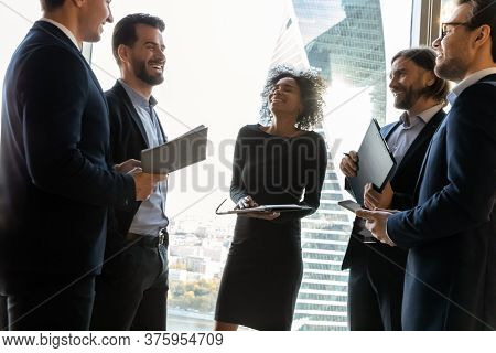 Overjoyed Group Of Diverse Employees Having Fun In Modern Office.
