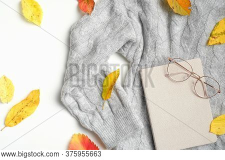 Autumn Feminine Workspace With Fallen Leaves, Sweater, Diary And Glasses. Flat Lay Composition For B