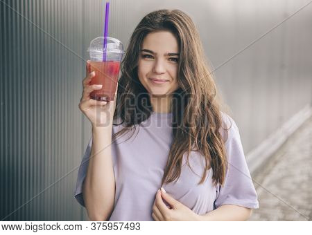 Young Stylish Trendy Woman Isolated Over Grey Blue Background. Cheerful Positive Girl Posing On Came