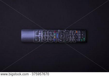 Tv Control On A Black Background. Multi Control Concept. Remote Control. Black Minimal Design Concep