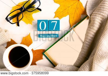 November 7. Flat Lay Photo With Cube Calendar With Date November 7th, Open Mockup Book And Glasses,