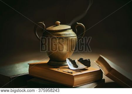 Still Life With Old Things - Thick Encyclopedias And A Copper Lamp With An Ornament And With A Genie