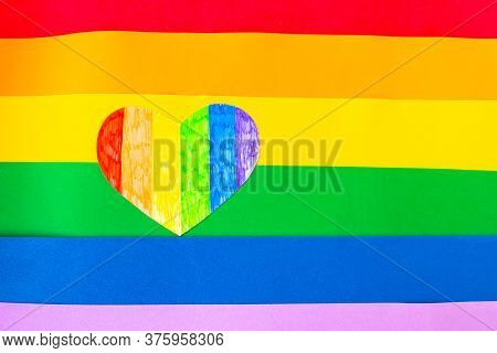 Heart In Lgbtq Colors On Lgbtq Flag Background, Top View, Copy Space For The Text