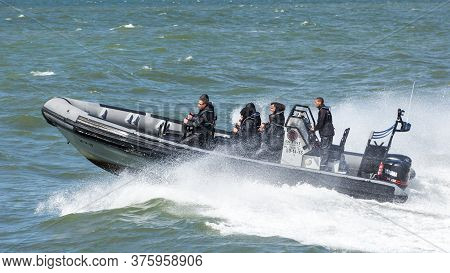 Scheveningen, Netherlands, May 30, 2015: Tourists Enjoy A High Speed Jet Boat Ride In The North Sea