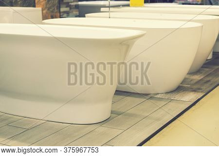 Baths In The Plumbing Store. Sanitary Engineering Shop. White Bathrooms. Baths In The Plumbing Store