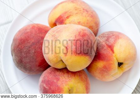 A Few Ripe Peaches Lie On A Plate