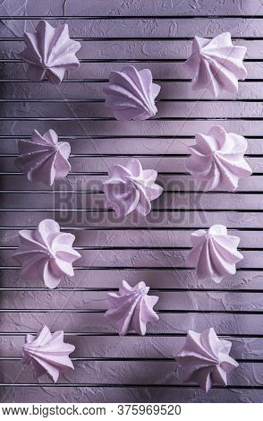 Pattern With Few Delicate Pink Homemade Meringue Cookies Cooling Down On Steel Metal Grate. Textured