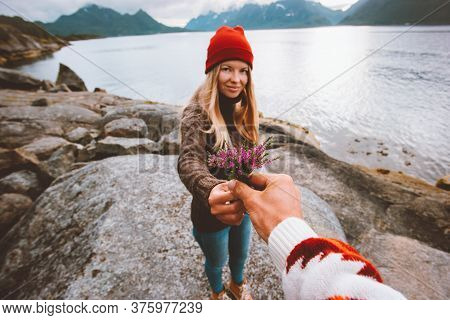 Couple In Love Man Giving Flowers To Young Woman Outdoor Travel Lifestyle Vacations Friendship Happy