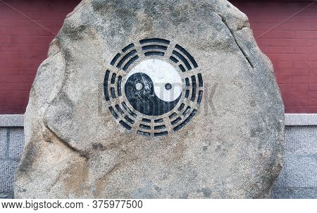 A Black And White Taoist Ying Yang Symbol On A Rock Within The Taiqing Scenic Area In Qingdao China