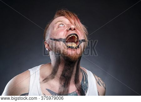 Photo Of A Scary Mad Man With Maggots In His Mouth