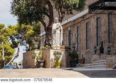 Haifa, Israel, July 10, 2020 : The Large Stone Statue Of The Virgin Mary In The Courtyard Of The Ste