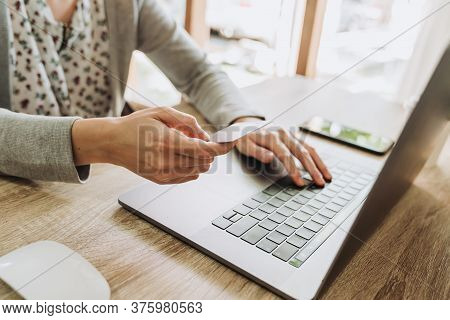 Woman Hand Holding Credit Card And Using Laptop For Shopping Online