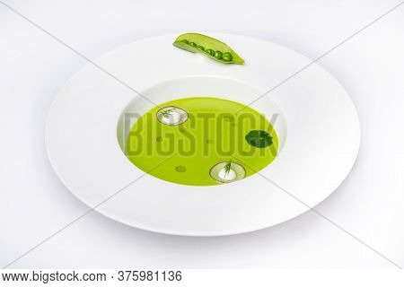 Soup On A White Plate On A White Plate With A Top View