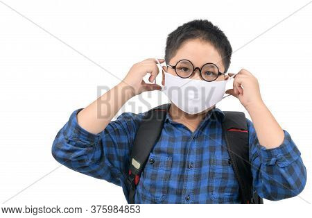 A High School Boy Student Wearing Mask And Eye Glasses Carrying  Backpack Isolated On White Backgrou