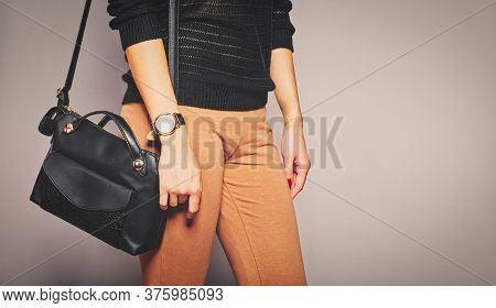 Girl Is Caring Her Handbag On Her Shoulder