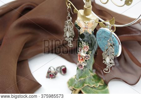 Beautiful Jewellery Close-up. Earrings, Neck Less And Rings On The Table. A Collection Of Jewelry. J